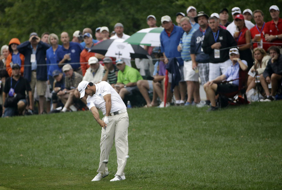Photo - Jason Day, of Australia, hits from rough on the 10th hole during the second round of the PGA Championship golf tournament at Valhalla Golf Club on Friday, Aug. 8, 2014, in Louisville, Ky. (AP Photo/David J. Phillip)