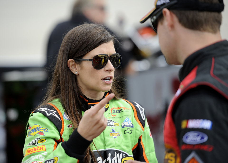 Nationwide Series driver Danica Patrick, left, talks with Ricky Stenhouse Jr., right, during qualifying for the OneMain Financial 200 NASCAR Nationwide Series auto race, Saturday, Sept. 29, 2012, in Dover, Del. (AP Photo/Nick Wass)