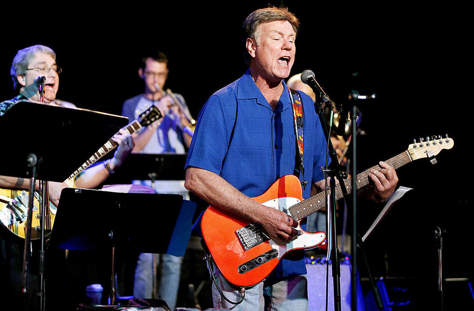 Photo - Greg Dennis performs with the Old Bulldog Band at the UCO Jazz Lab on Friday, August 9, 2013. The band, composed of former Edmond Memorial High School graduates from the 60's and 70's, started a few years ago when Greg Moss wanted to put a band together for his 40th high school reunion. Old Bulldog Band plays rock hits from the 60's and 70's which Moss and the other band members love playing.