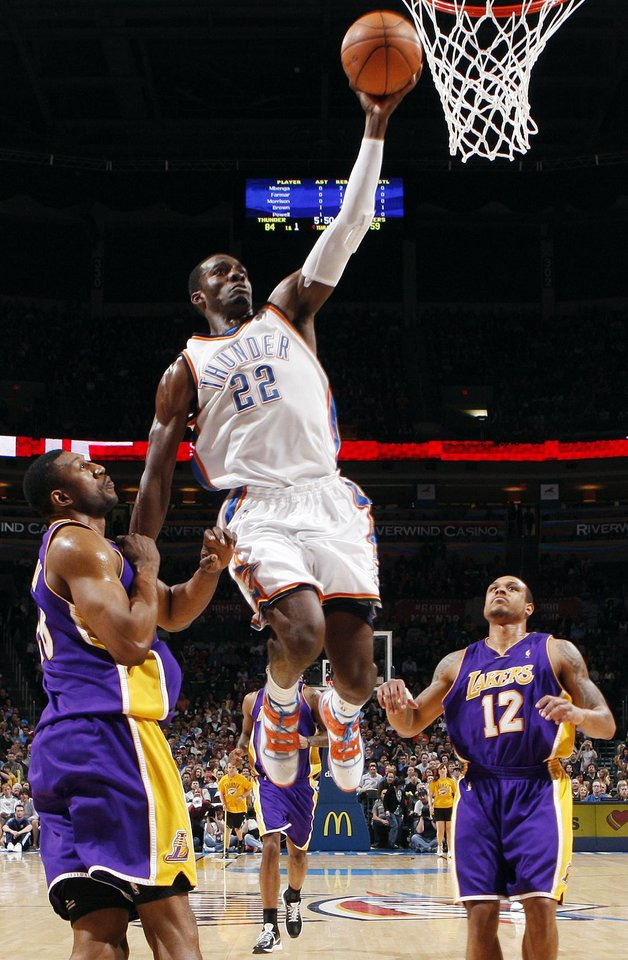Photo - Jeff Green (22) of Oklahoma City flies to the hoop between DJ Mbenga (28), left, and, Shannon Brown (12) of Los Angeles during the NBA basketball game between the Los Angeles Lakers and the Oklahoma City Thunder at the Ford Center in Oklahoma City, Friday, March 26, 2010. Oklahoma City won, 91-75. Photo by Nate Billings, The Oklahoman