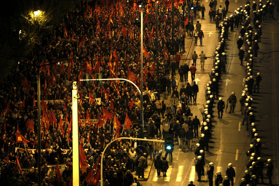 A police cordon separates demonstrators from the Embassy of the United States, right, in Athens on Saturday, Nov. 17, 2012. Several thousand marchers are commemorating the 39th anniversary of a deadly student uprising against the then ruling dictatorship, with more than 6,000 police deployed in the center of the Greek capital. (AP Photo/Petros Giannakouris)