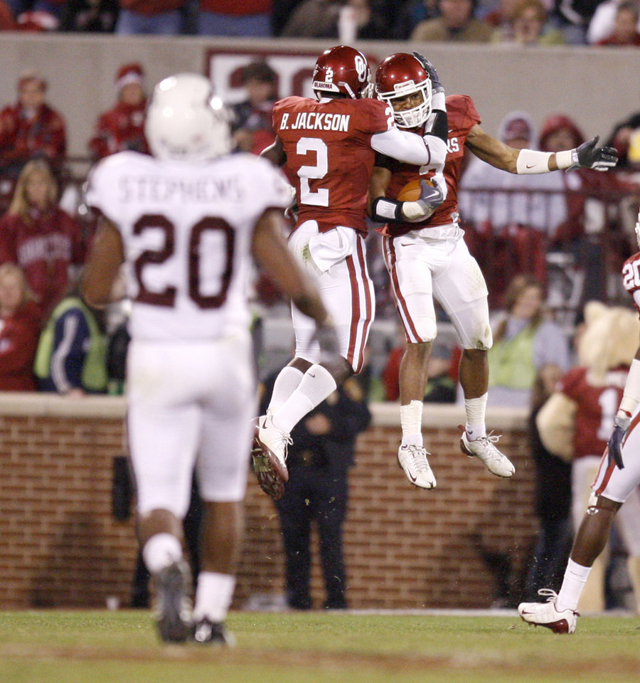 Photo - OU's Jonathan Nelson, right, celebrates with Brian Jackson after Nelson intercepted a pass during the Big 12 college football game between the University of Oklahoma Sooners and the Texas A&M Aggies at Gaylord Family - Oklahoma Memorial Stadium in Norman, Okla., Saturday, November 14, 2009.  Photo by Bryan Terry, The Oklahoman