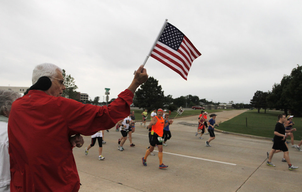 Bill Parker, of Oklahoma City, cheers on runners during the twelfth annual Oklahoma City Memorial Marathon in Oklahoma City, Sunday, April 29, 2012.  Photo by Garett Fisbeck, For The Oklahoman