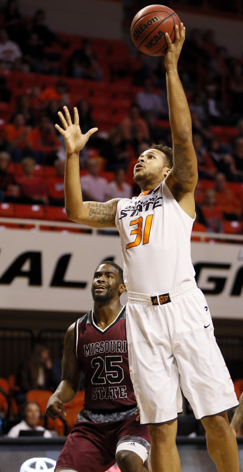 Photo - OSU's Chris Oliver (31) shoots in front of Missouri State's Jordan Martin (25) during a men's college basketball game between Oklahoma State and Missouri State at Gallagher-Iba Arena in Stillwater, Okla., Saturday, Dec. 5, 2015. Missouri State won 64-63. Photo by Nate Billings, The Oklahoman