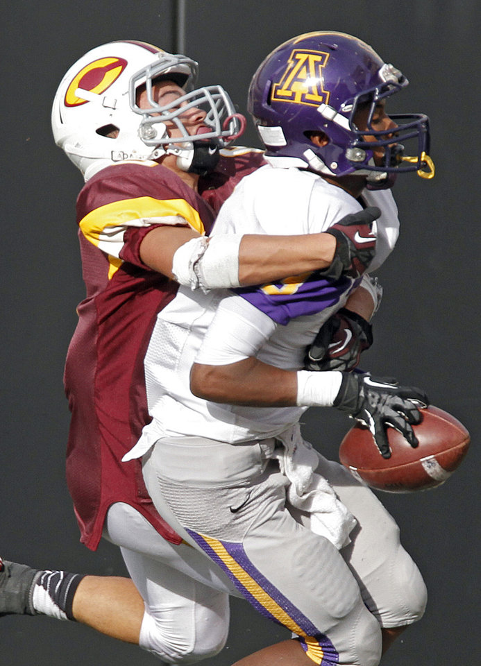 Anadarko\'s Josh Parton (3) makes an interception in front of Clinton\'s Devon Mitchell (6) during the Class 4A Oklahoma state championship football game between Anadarko and Clinton at Boone Pickens Stadium on Saturday, Dec. 1, 2012, in Stillwater, Okla. Photo by Chris Landsberger, The Oklahoman