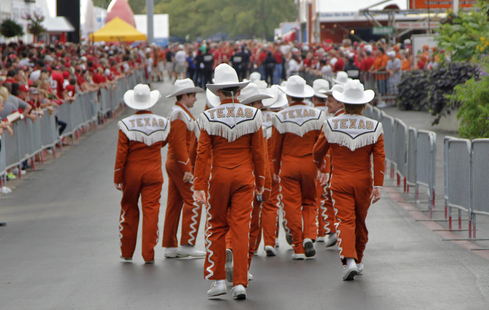 Photo - Members of the Texas band walk the fair during the Red River Rivalry college football game between the University of Oklahoma (OU) and the University of Texas (UT) at the Cotton Bowl in Dallas, Saturday, Oct. 13, 2012. Photo by Chris Landsberger, The Oklahoman