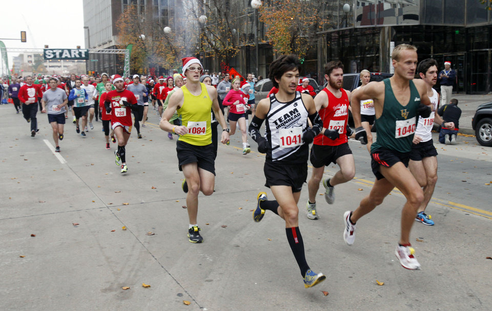 Runners race toward the finish line during the SandRidge Santa Run in downtown Oklahoma City, OK, Saturday, December 8, 2012,  By Paul Hellstern, The Oklahoman