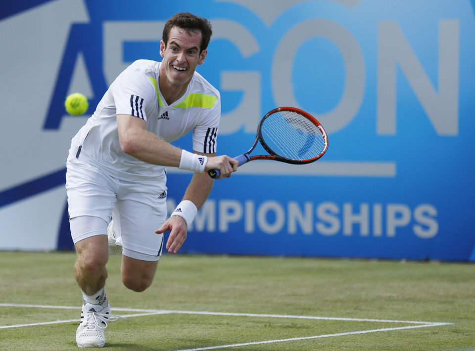 Photo - British Andy Murray in action against Paul-Henri Mathieu of France during the Aegon Championships tennis tournament at The Queen's Club in London, Wednesday June 11, 2014.  (AP Photo / Jonathan Brady, PA) UNITED KINGDOM OUT - NO SALES - NO ARCHIVES