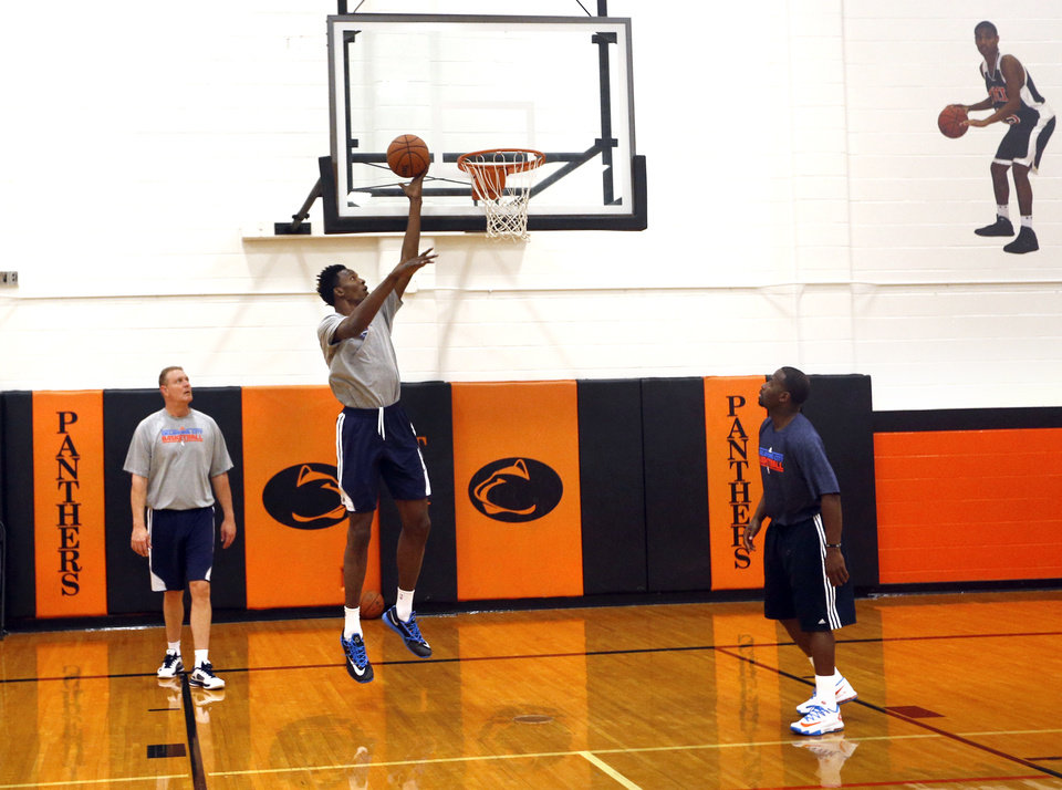 Photo - Oklahoma City's Hasheem Thabeet (34) shoots baskets at the Oklahoma City Thunder practice at the Texas Military Institute in San Antonio, Tuesday, May 20, 2014. PHOTO BY SARAH PHIPPS, The Oklahoman