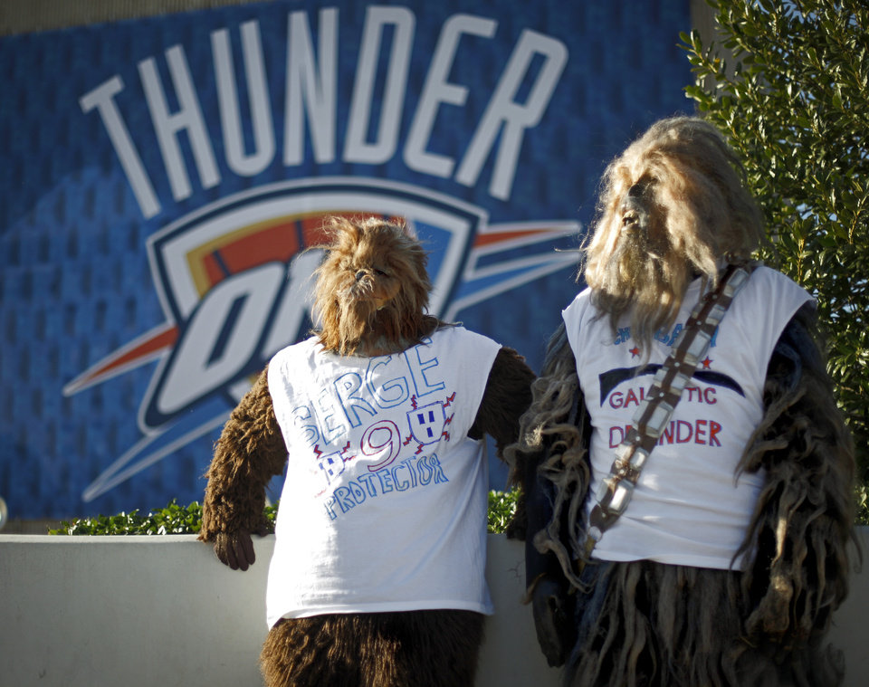 Photo - Josh Pound, left, and Doug Richardson of Midwest City wait outside the Oklahoma City Arena before game two of the Western Conference semifinals between the Memphis Grizzlies and the Oklahoma City Thunder in the NBA basketball playoffs at Oklahoma City Arena in Oklahoma City, Tuesday, May 3, 2011. Photo by Bryan Terry, The Oklahoman