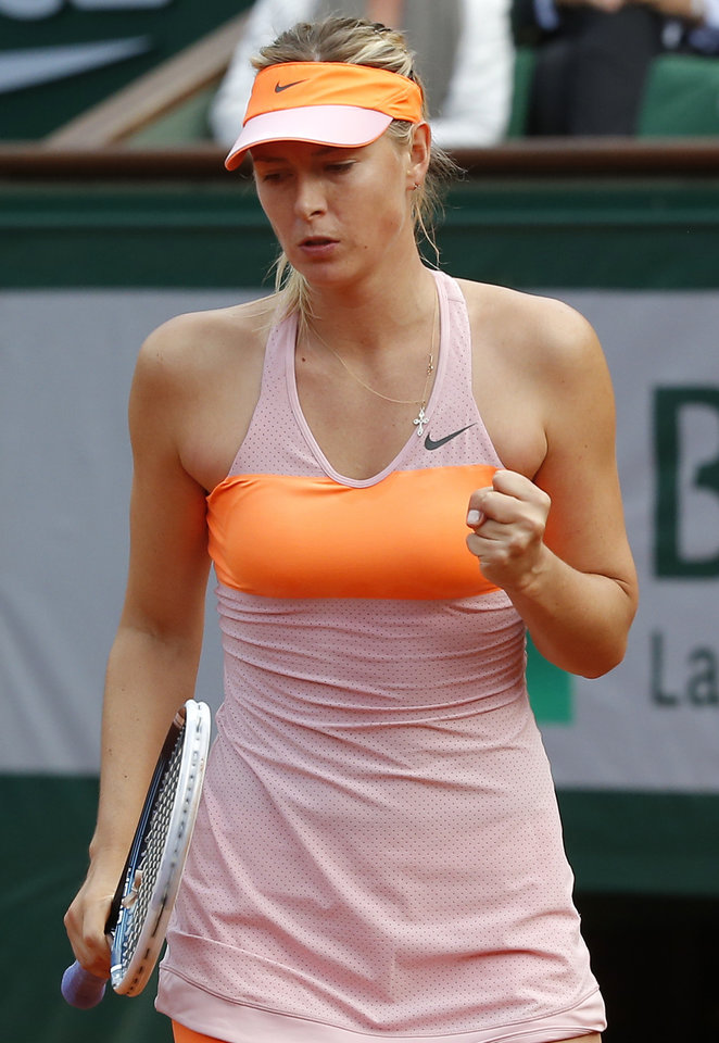 Photo - Russia's Maria Sharapova clenches her fist as she defeats Argentina's Paula Ormaechea during their third round match of  the French Open tennis tournament at the Roland Garros stadium, in Paris, France, Friday, May 30, 2014. Sharapova won 6-0, 6-0.  (AP Photo/Michel Euler)