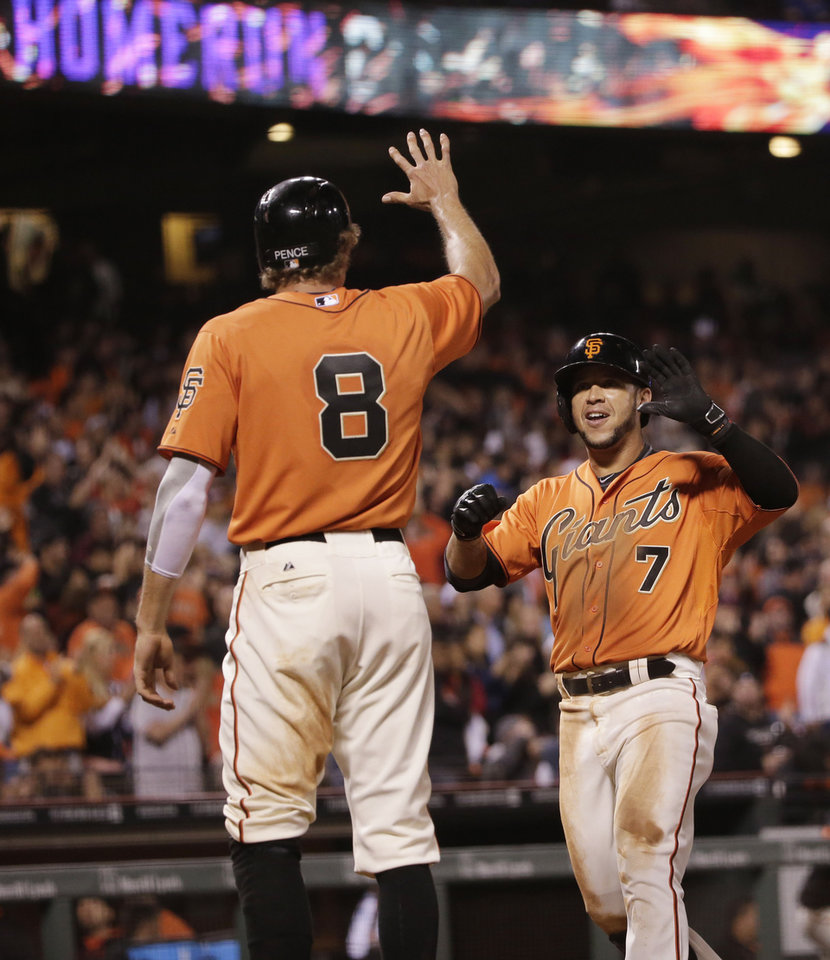 Photo - San Francisco Giants' Gregor Blanco, right, celebrates his two-run home run with teammate Hunter Pence during the fifth inning of a baseball game against the Milwaukee Brewers on Friday, Aug. 29, 2014, in San Francisco. (AP Photo/Marcio Jose Sanchez)