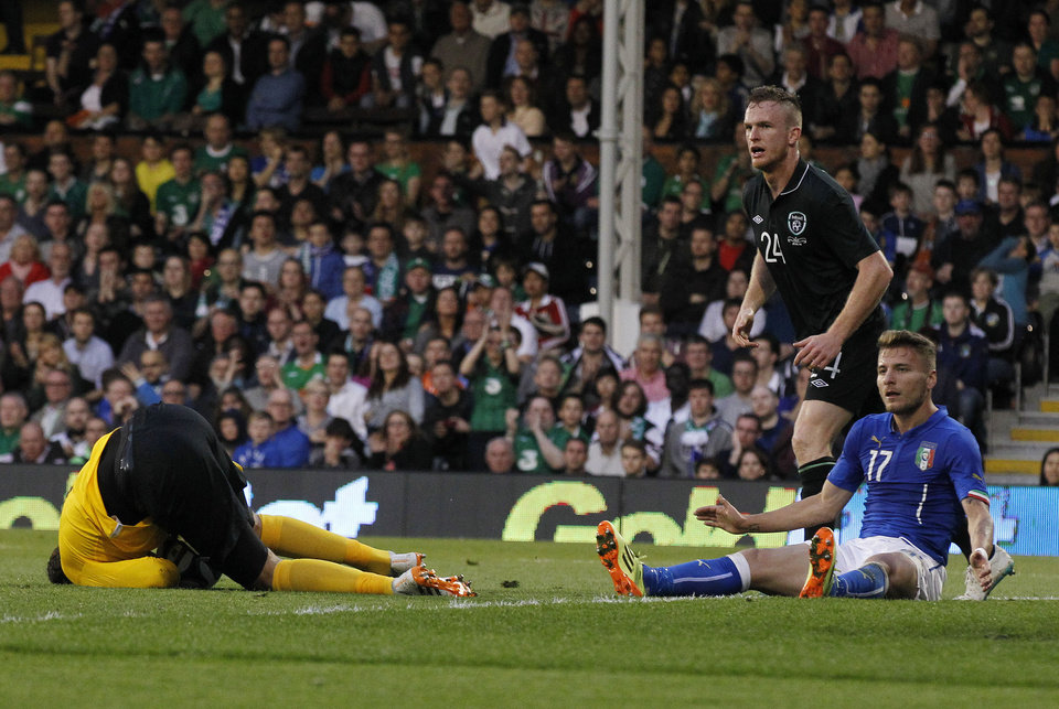 Photo - Italy's Ciro Immobile, right, reacts to his missed chance to score pass Republic of Ireland's goalkeeper David Forde, left, during their international friendly soccer match at Craven Cottage, London, Saturday, May 31, 2014. (AP Photo/Sang Tan)