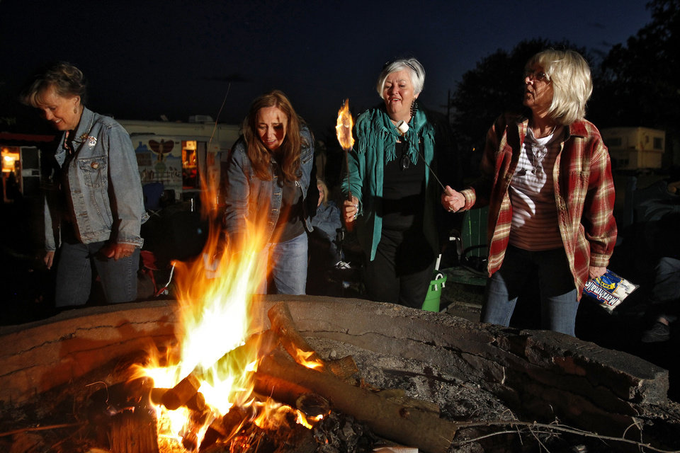 Photo - Members of Sisters on the Fly roast marshmallows at a campfire in Louisburg, Kansas, on April 21, 2012. Sisters on the Fly is a national group of camping enthusiasts founded by two actual sisters who love fly-fishing in Montana. (Jill Toyoshiba/Kansas City Star/MCT)
