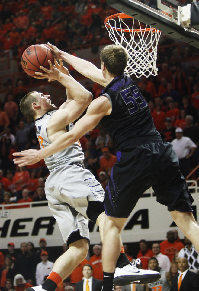 Photo - Kansas State defender Will Spradling (55) blocks the shot of Oklahoma State guard Phil Forte during an NCAA college basketball game in Stillwater, Okla., Monday, March 3, 2014. Oklahoma State won 77-61. (AP Photo/The Oklahoman, KT King)