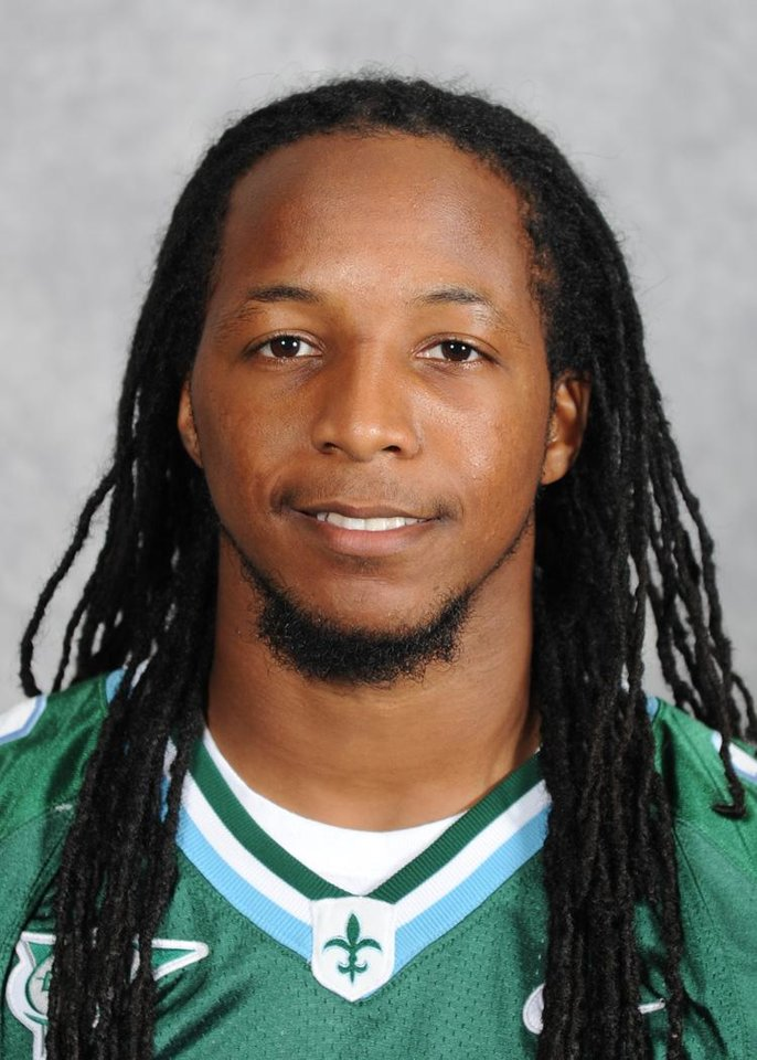 Photo -   In an undated photo provided by Tulane University, Tulane safety Devon Walker poses for a photo in New Orleans. Walker fractured his spine in a head-to-head collision with a teammate during a game in Tulsa, Okla., the team doctor said Saturday, Sept. 8, 2012. Dr. Buddy Savoie said during a postgame news conference that Walker is in stable condition and will need spinal surgery in the