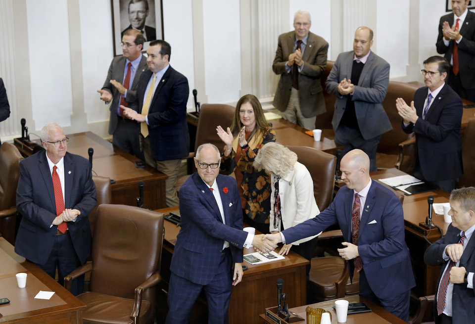 Photo - His colleagues in the House of Representatives stand and applaud colleague Harold Wright, Weatherford, center,  after members elected him to the position of speaker pro tempore. Wright addressed lawmakers after he was sworn in. The state Legislature met in their separate chambers at the state Capitol Tuesday afternoon, Jan. 8, 2019, for an organizational day.  Senators joined state representatives in the House to conduct a brief joint session. Photo by Jim Beckel, The Oklahoman.