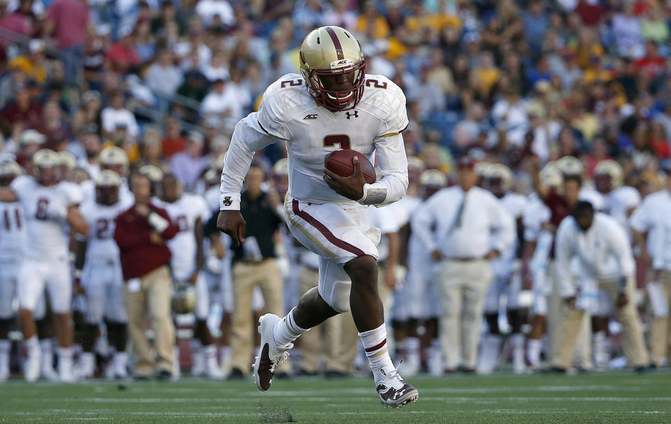 Photo - Boston College quarterback Tyler Murphy (2) carries the ball on a touchdown run during the third quarter of an NCAA college football game against Massachusetts in Foxborough, Mass., Saturday, Aug. 30, 2014. Boston College won 30-7. (AP Photo/Michael Dwyer)