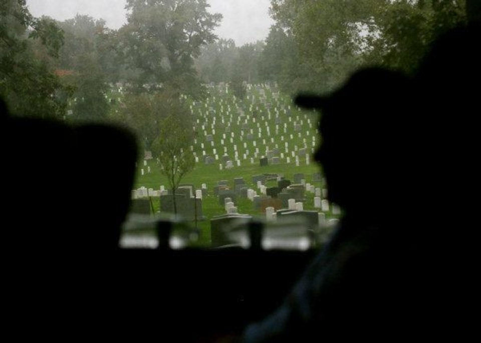 Photo - Maurice Freese, an Army veteran from Oklahoma City, watches Arlington National Cemetery pass by from a bus window during a tour of memorials in Arlington, Virginia on Wednesday, Oct. 12, 2011. Veterans from Oklahoma visited the different memorials and the cemetery during an Oklahoma Honor Flight to Virginia and Washington D.C. on Wednesday. Photo by John Clanton, The Oklahoman ORG XMIT: KOD