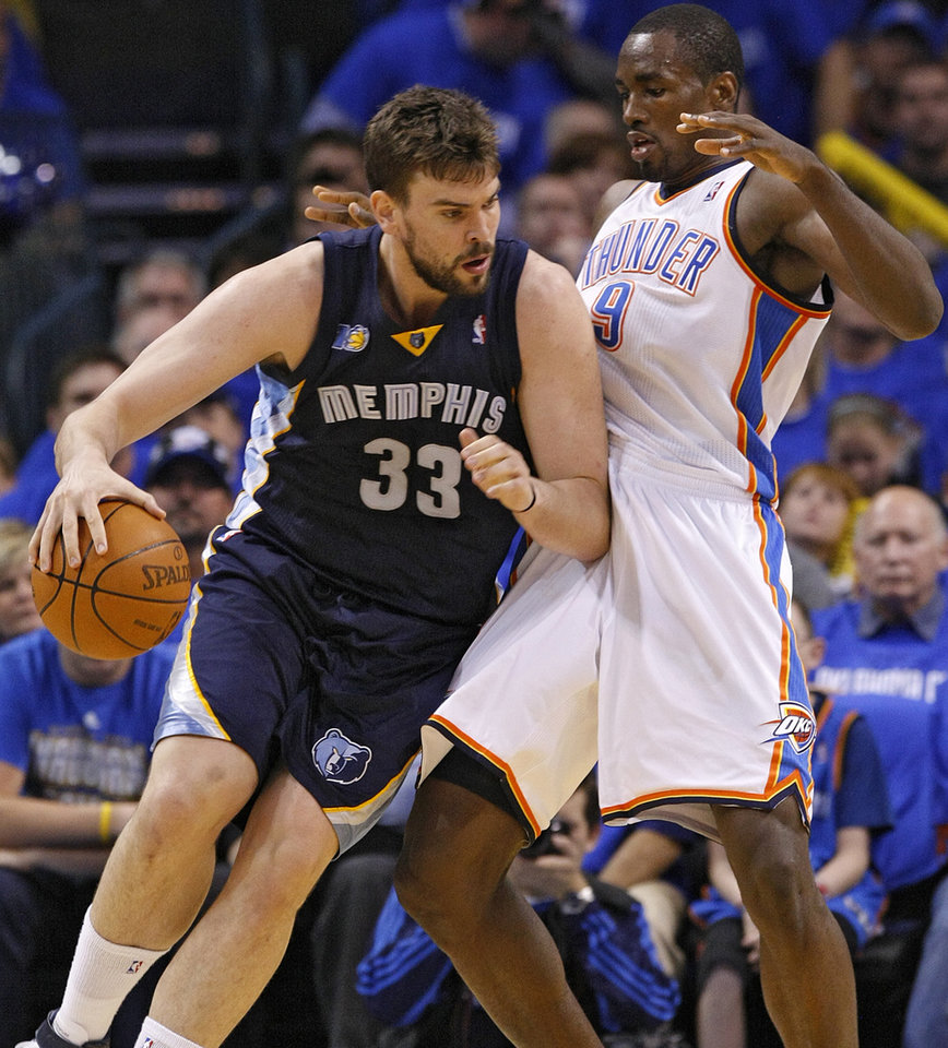 Memphis' Marc Gasol (33) drives against Oklahoma City Serge Ibaka (9) during game one of the Western Conference semifinals between the Memphis Grizzlies and the Oklahoma City Thunder in the NBA basketball playoffs at Oklahoma City Arena in Oklahoma City, Sunday, May 1, 2011. Photo by Chris Landsberger, The Oklahoman