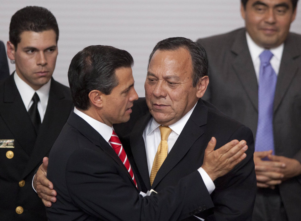 "FILE - In this March 11, 2013 photo, Mexico\'s President Enrique Pena Nieto, left, embraces President of the Democratic Revolution Party (PRD) Jesus Zambrano at an event to sign an agreement that would create two new national television channels and form an independent regulatory commission in Mexico City. Mexico\'s government proposed a sweeping overhaul of the banking sector Wednesday, May 8, 2013, which is supported by Zambrano\'s PRD. Pena Nieto said ""The object is ... for banks to lend more, and more cheaply."" Critics warned it could launch a wave of foreclosures like those seen in Spain and the United States, while supporters said it is needed to spur banks to lend to Mexico\'s credit-starved businesses. (AP Photo/Alexandre Meneghini, File)"