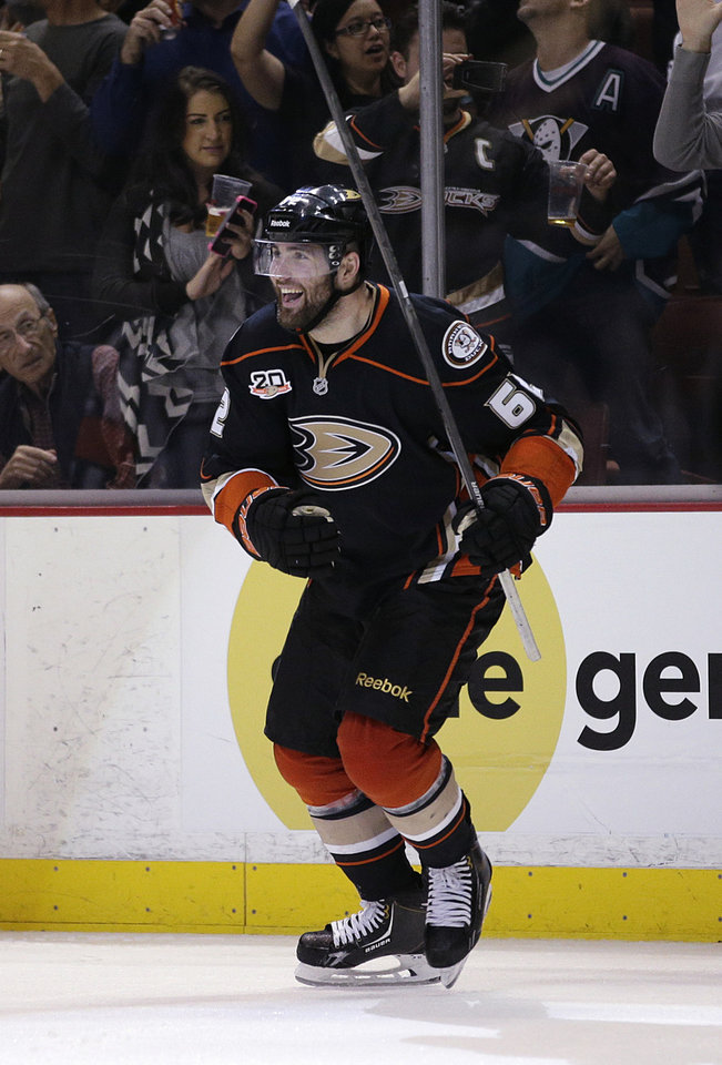 Photo - Anaheim Ducks' Patrick Maroon celebrates his goal against the San Jose Sharks during the second period of an NHL hockey game Wednesday, April 9, 2014, in Anaheim, Calif. (AP Photo/Jae C. Hong)