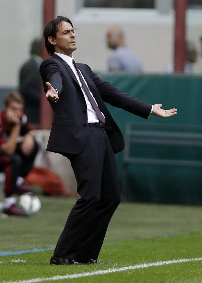 Photo - AC Milan coach Filippo Inzaghi opens his arms during a Serie A soccer match between AC Milan and Lazio, at the San Siro stadium in Milan, Italy, Sunday, Aug. 31, 2014. (AP Photo/Luca Bruno)