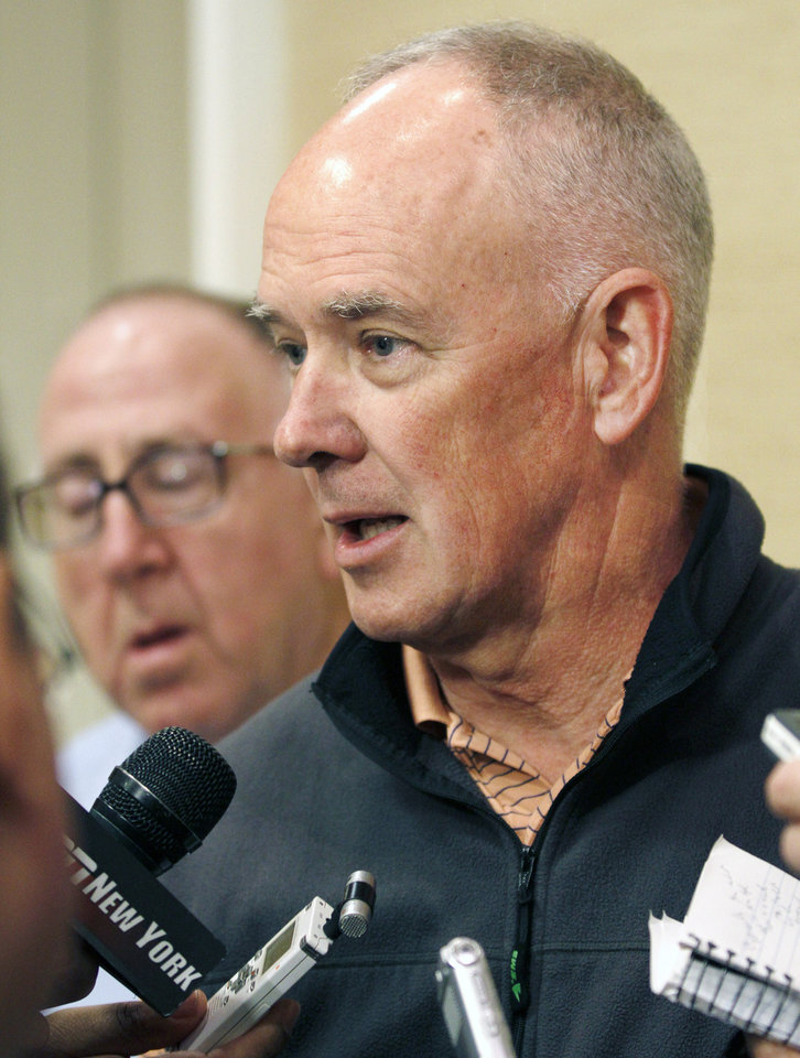 Photo - New York Mets general manager Sandy Alderson talks with the media at the annual baseball general managers meeting, Tuesday, Nov. 12, 2013, in Orlando, Fla. (AP Photo/Reinhold Matay)