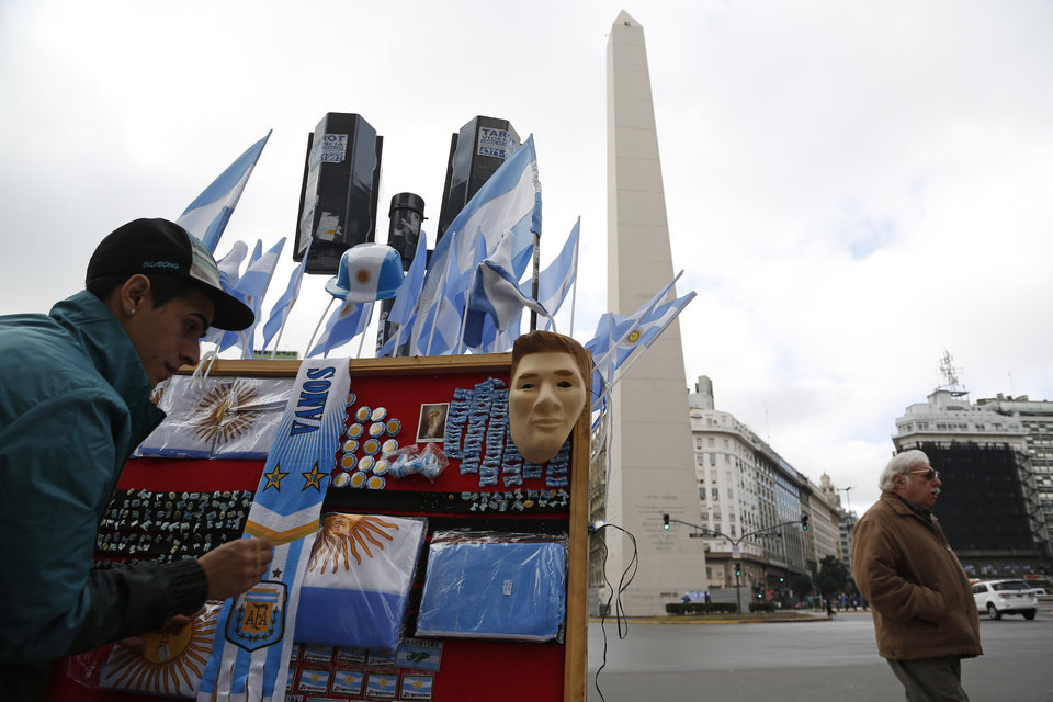 Photo - A vendor prepares his stand, complete with a mask of Argentina's player Lionel Messi, prior to the final Brazil World Cup game in Buenos Aires, Argentina, Sunday, July 13, 2014. Argentina will face Germany at the final match in Brazil on Sunday. (AP Photo/Jorge Saenz)