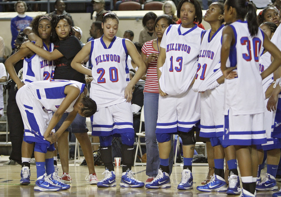Photo - CLASS 2A GIRLS HIGH SCHOOL BASKETBALL / STATE TOURNAMENT / REACTION: Millwood reacts after the loss to Snyder in the championship game of the 2A girls state championship tournament at the Big House in the State Fair Park on Saturday, March 12, 2011, in Oklahoma City, Okla.   Photo by Chris Landsberger, The Oklahoman ORG XMIT: KOD