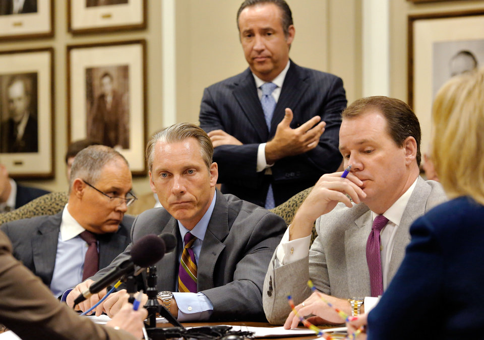 Photo - Grim expressions on the faces of state leaders as they hear a gloomy report by Preston Doerflinger, standing. From left, are Attorney General Scott Pruitt; State Treasurer Ken Miller; Lt. Gov. Todd Lamb and Gov. Mary Fallin, far right. Board of Equalization gathered to hear a finance report by Preston Doerflinger, Director and Secretary of Finance, Administration and Information Technology, Tuesday, Feb. 16, 2016, in the governorÕs large conference room at the state Capitol. Doerflinger also serves as the director of the Office of Management and Enterprise Services (OMES), the stateÕs central finance and operations agency.Photo by Jim Beckel, The Oklahoman.