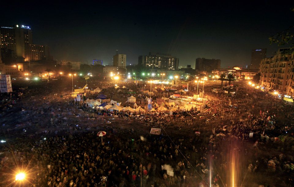 Thousands of Egyptian protesters gather in Tahrir Square, Cairo, Egypt, Friday, Jan. 25, 2013. Two years after Egypt's revolution began, the country's schism was on display Friday as the mainly liberal and secular opposition held rallies saying the goals of the pro-democracy uprising have not been met and denouncing Islamist President Mohammed Morsi. (AP Photo/Khalil Hamra) ORG XMIT: KH140