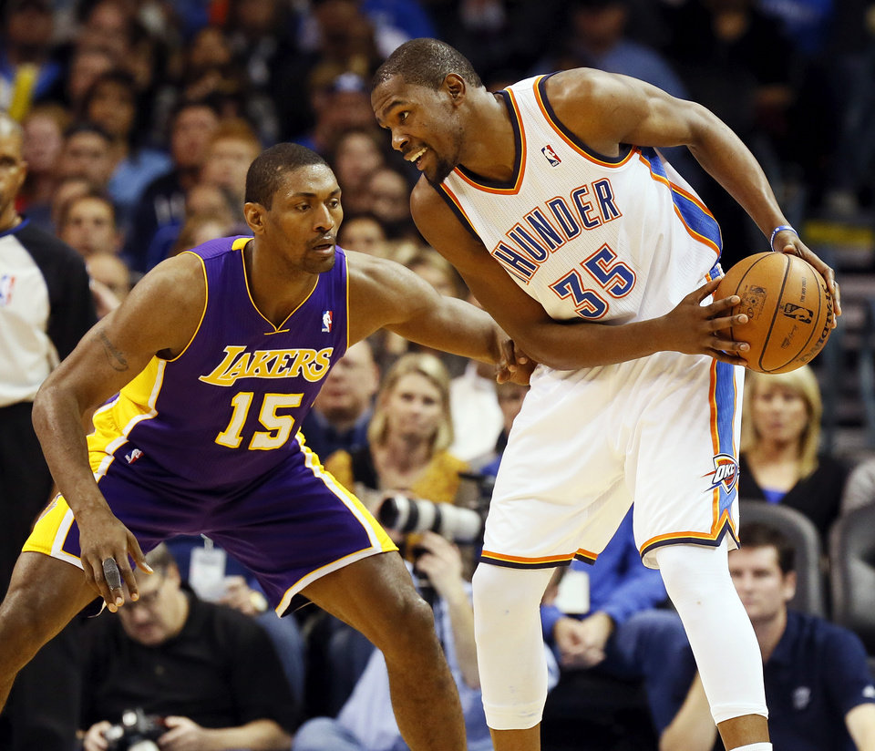 Oklahoma City\'s Kevin Durant (35) keeps the ball away from Los Angeles\' Metta World Peace (15) during an NBA basketball game between the Oklahoma City Thunder and the Los Angeles Lakers at Chesapeake Energy Arena in Oklahoma City, Friday, Dec. 7, 2012. Oklahoma City won, 114-108. Photo by Nate Billings, The Oklahoman