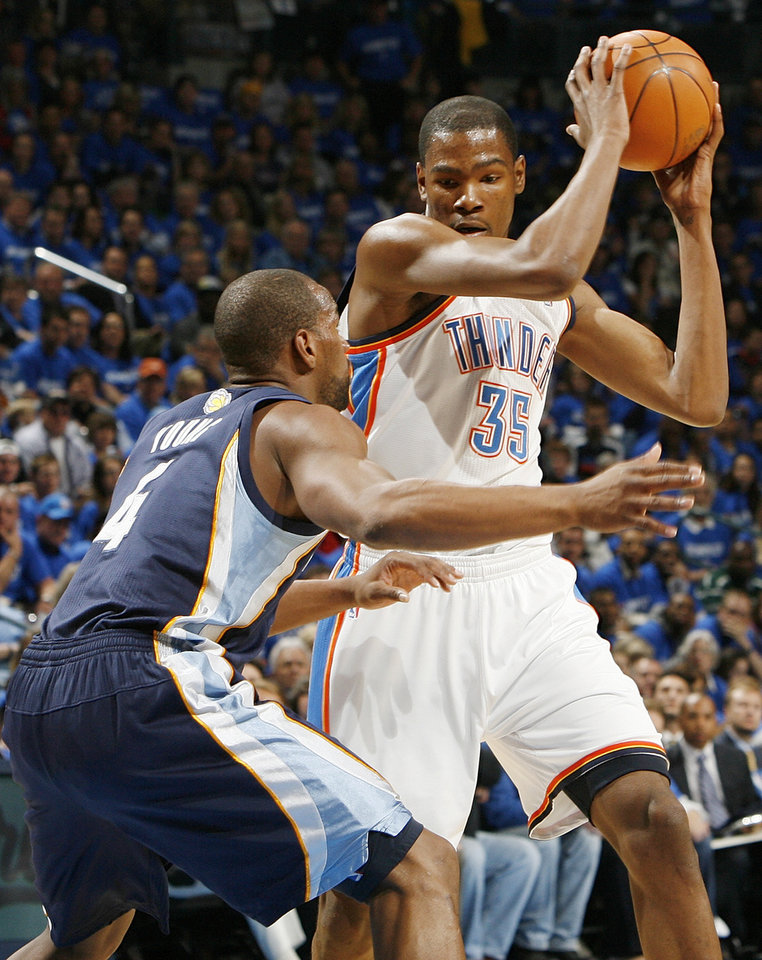 Photo - Oklahoma City's Kevin Durant (35) keeps the ball away from Sam Young (4) of Memphis in the first half during game one of the Western Conference semifinals between the Memphis Grizzlies and the Oklahoma City Thunder in the NBA basketball playoffs at Oklahoma City Arena in Oklahoma City, Sunday, May 1, 2011. Photo by Nate Billings, The Oklahoman