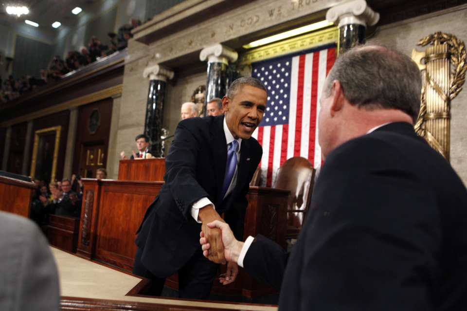 Photo - President Barack Obama arrives to deliver the State of Union address before a joint session of Congress in the House chamber Tuesday, Jan. 28, 2014, in Washington. (AP Photo/Larry Downing, Pool)