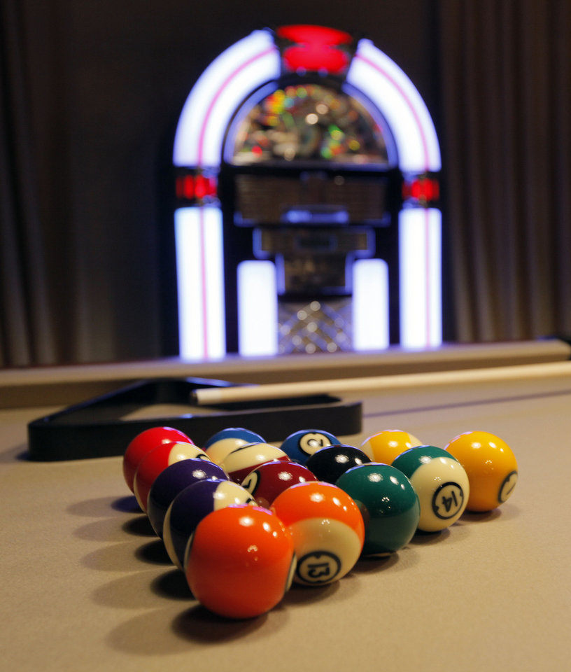 Photo - Pool balls splash color in a basement game room of the Symphony Show House. Rosinna Gies and Tony Webb of Amini's Galleria designed Room 21 of Jazz Age Manor.  NATE BILLINGS - The Oklahoman