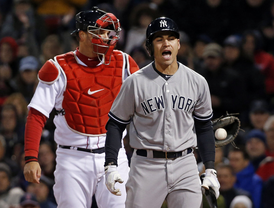 Photo - New York Yankees' Jacoby Ellsbury reacts after striking out as Boston Red Sox catcher A.J. Pierzynski holds the ball in the fifth inning of a baseball game at Fenway Park in Boston, Wednesday, April 23, 2014. (AP Photo/Elise Amendola)