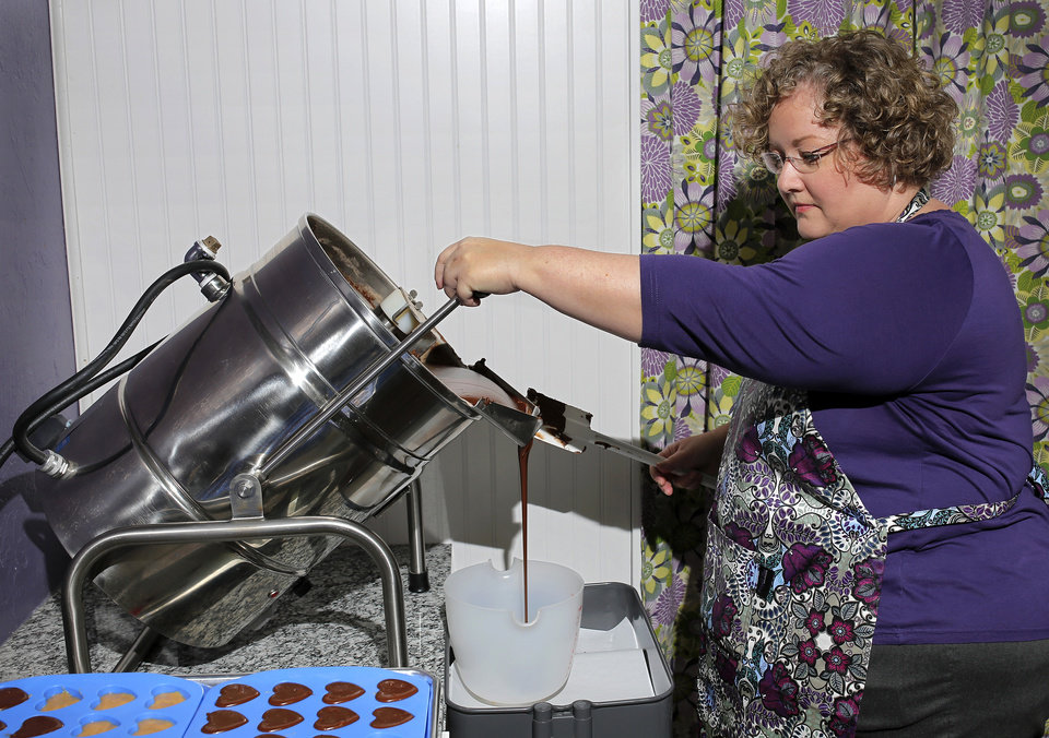 Photo -  Annette Gunter pours liquid chocolate into a pitcher. Photo by Jim Beckel, The Oklahoman   Jim Beckel -  THE OKLAHOMAN