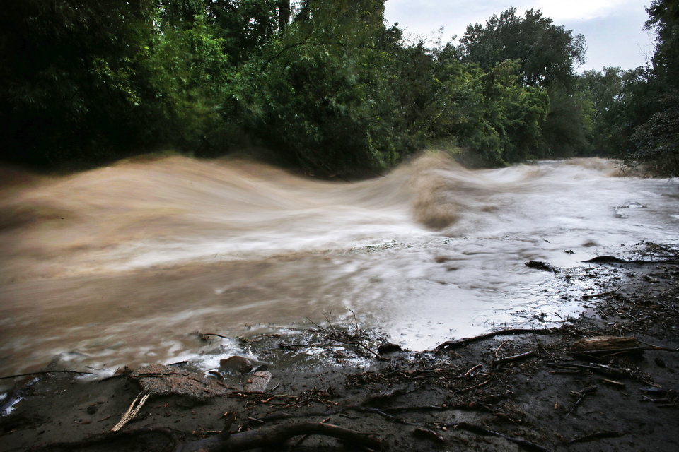 Photo - Boulder Creek roils at high speed after days of record rain and flooding, at the base of Boulder Canyon, Colo., Friday Sept. 13, 2013 in Boulder. People in Boulder were ordered to evacuate as water rose to dangerous levels amid a storm system that has been dropping rain for a week. Rescuers struggled to reach dozens of people cut off by flooding in mountain communities, while residents in the Denver area and other areas were warned to stay off flooded streets. (AP Photo/Brennan Linsley)