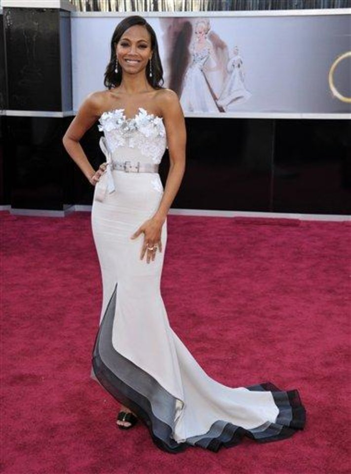 Photo - Actress Zoe Saldana arrives at the 85th Academy Awards at the Dolby Theatre on Sunday Feb. 24, 2013, in Los Angeles. (Photo by John Shearer/Invision/AP)