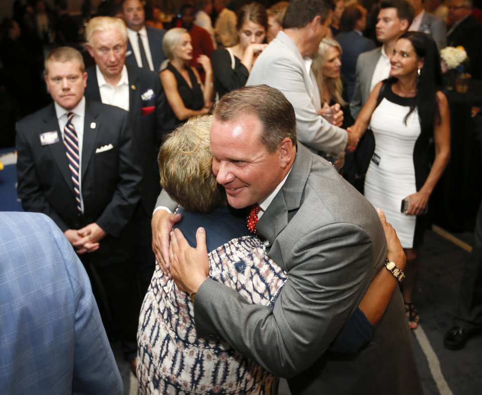 Photo - Lt. Gov. Todd Lamb hugs Peggy Smalley after speaking to supporters and conceding the Republican primary for governor at his watch party at the Renaissance Waterford Oklahoma City Hotel in Oklahoma City, Tuesday, June 26, 2018. Photo by Nate Billings, The Oklahoman