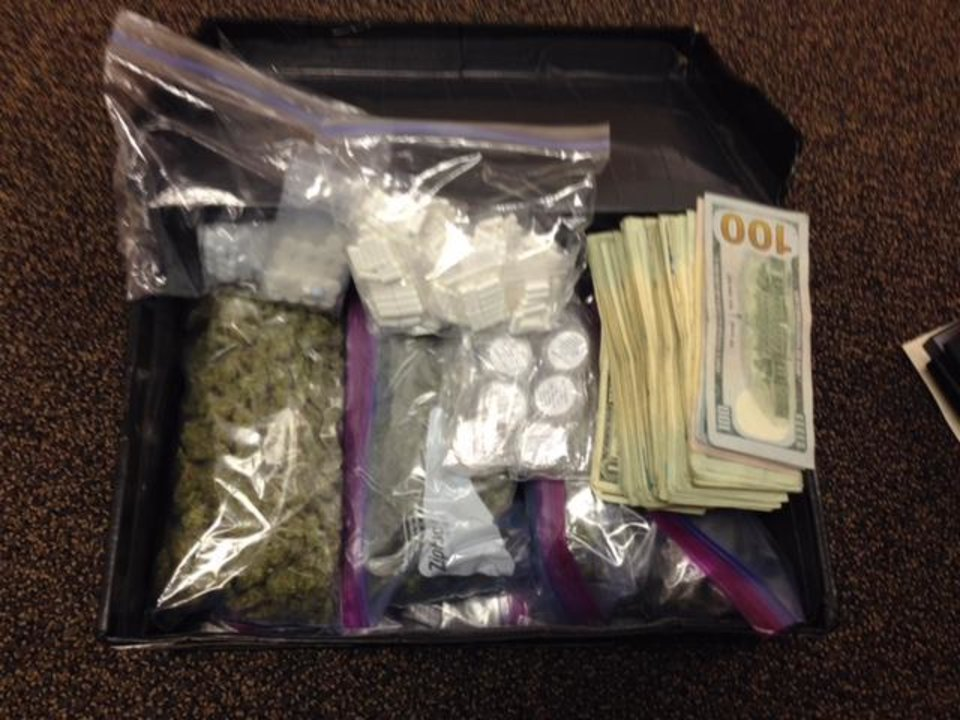 Photo -  Drugs and cash were confiscated from a Yukon residence on Tuesday. [Photo provided by Canadian County Sheriff's Department.]