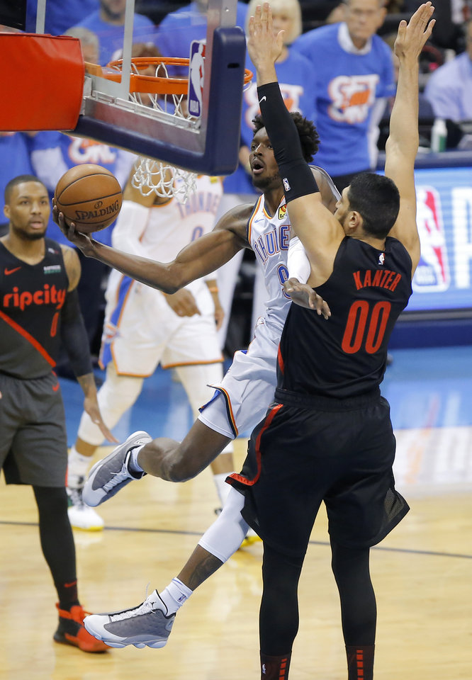 Photo - Oklahoma City's Jerami Grant (9) goes to the basket past Portland's Enes Kanter (00) during Game 4 in the first round of the NBA playoffs between the Portland Trail Blazers and the Oklahoma City Thunder at Chesapeake Energy Arena in Oklahoma City, Sunday, April 21, 2019. Photo by Bryan Terry, The Oklahoman