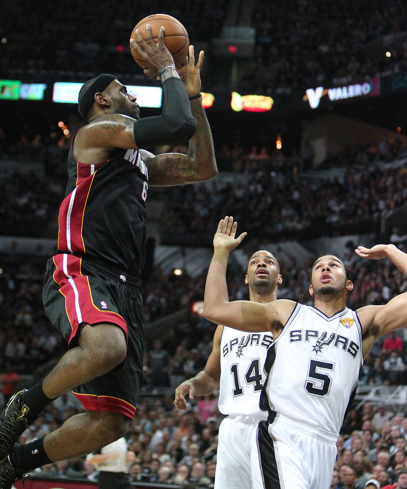 Photo - Miami Heat forward LeBron James, left, drives against San Antonio guard Gary Neal,  center, and teammate guard Cory Joseph during the first quarter of Game 4 of the NBA Finals basketball series on Thursday, June 13, 2013, in San Antonio.  (AP Photo/El Nuevo Herald, David Santiago)  MAGAZINES OUT