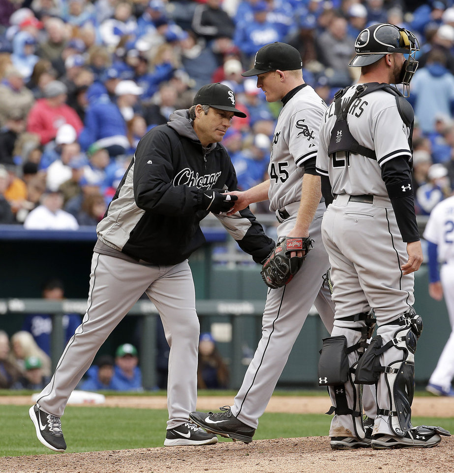 Photo - Chicago White Sox starting pitcher Erik Johnson (45) hands the ball to manager Robin Ventura as he leaves during the fifth inning of a home opener baseball game against the Kansas City Royals, Friday, April 4, 2014, in Kansas City, Mo. (AP Photo/Charlie Riedel)