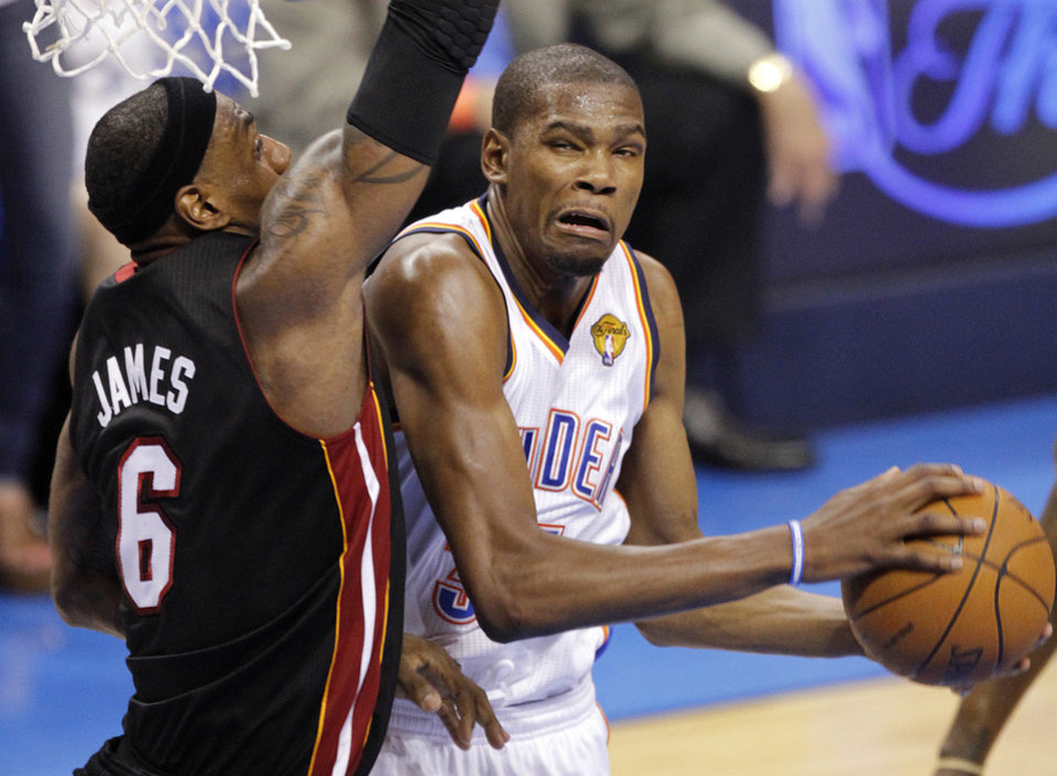 NBA BASKETBALL: Oklahoma City's Kevin Durant (35) drives past Miami's LeBron James (6) during Game 2 of the NBA Finals between the Oklahoma City Thunder and the Miami Heat at Chesapeake Energy Arena in Oklahoma City, Thursday, June 14, 2012. Photo by Chris Landsberger, The Oklahoman