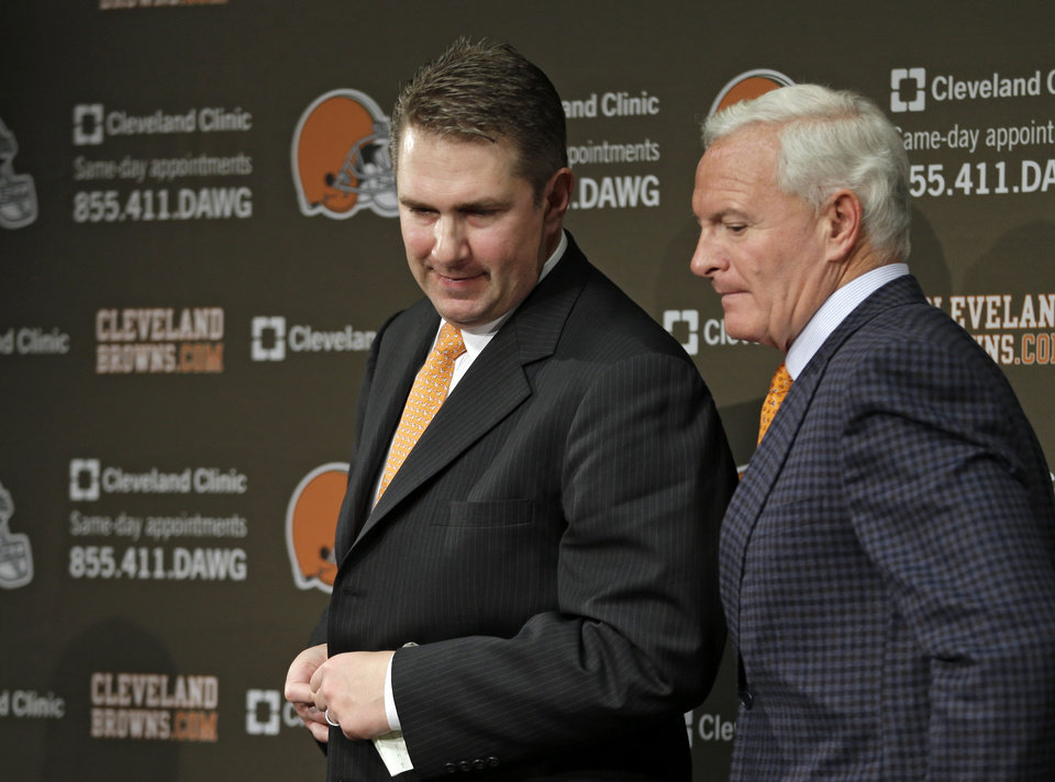 Photo - New Cleveland Browns head coach Rob Chudzinski, left, leaves his introductory news conference with owner Jimmy Haslam at the NFL football team's practice facility in Berea, Ohio Friday, Jan. 11, 2013. (AP Photo/Mark Duncan)