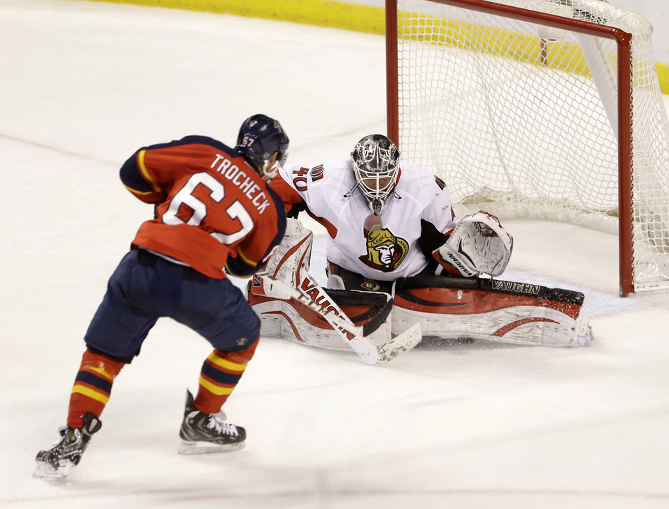 Photo - Florida Panthers center Vincent Trocheck (67) scores a goal against Ottawa Senators goalie Robin Lehner (40) during the second period of an NHL hockey game, Tuesday, March 25, 2014 in Sunrise, Fla. (AP Photo/Wilfredo Lee)
