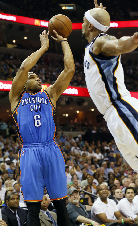 Photo - Oklahoma City's Derek Fisher (6) takes a 3-point shot against Memphis' Jerryd Bayless (7) during Game 3 in the second round of the NBA basketball playoffs between the Oklahoma City Thunder and Memphis Grizzles at the FedExForum in Memphis, Tenn.,  Saturday, May 11, 2013. Photo by Nate Billings, The Oklahoman