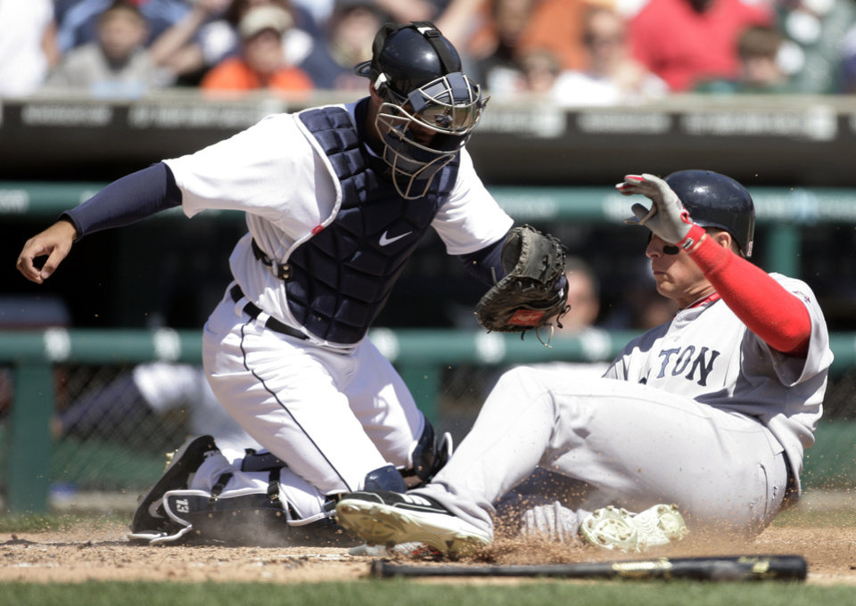 Photo -   Boston Red Sox's Ryan Sweeney, right, scores past Detroit Tigers catcher Alex Avila on a sacrifice fly by Nick Punto in the third inning of a baseball game Sunday, April 8, 2012, in Detroit. (AP Photo/Duane Burleson)